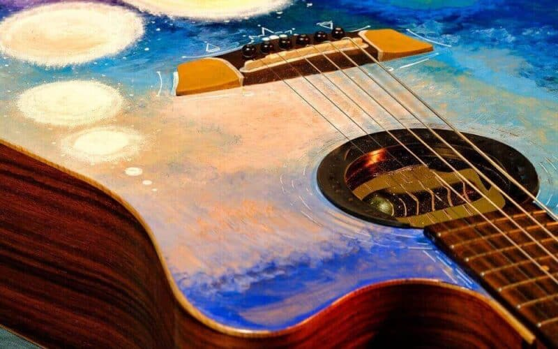 Will painting an acoustic guitar affect the sound